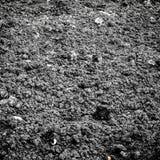 Черная предпосылка текстуры почвы Стоковое Фото