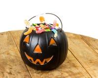 Черная пластичная тыква на деревянном столе Стоковое Изображение