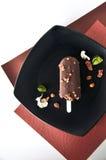 Черная плита бара мороженого на предпосылке цвета Стоковое Изображение