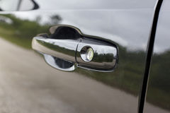Черная ручка автомобильной двери Стоковые Фотографии RF