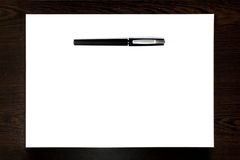 Черная ручка изолированная на листе белой бумаги Стоковые Фотографии RF