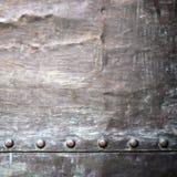 Черная текстура металлической пластины или панцыря с заклепками Стоковые Фотографии RF