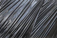 Черная текстура предпосылки фильма упаковки полиэтилена Стоковое Изображение RF