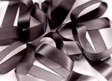 Черная тесемка ткани   стоковые изображения
