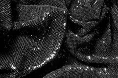 Черная ткань с paillettes делает ослеплять дебютом этот черный b стоковое фото