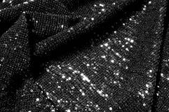 Черная ткань с paillettes делает ослеплять дебютом этот черный b стоковые фото