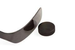 Черная хоккейная клюшка с шайбой Стоковые Изображения