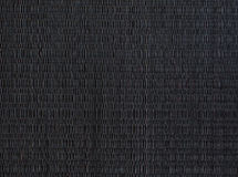 Черная циновка, сплетенная текстура placemat Стоковые Изображения RF