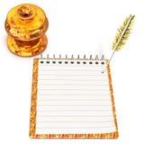 Чернильница и тетрадь золота Стоковая Фотография