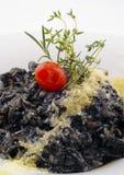 Черное блюдо ризотто Стоковая Фотография