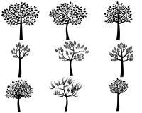 Черное дерево silhouettes собрание Иллюстрация штока