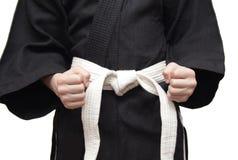 Черное кимоно и белый пояс Стоковые Фотографии RF