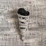 Черное мороженое в конусе waffle в форме мумии Стоковое фото RF