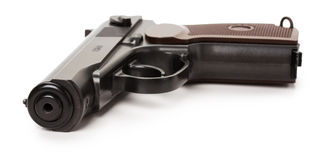 Черное оружие изолированное на белой предпосылке Стоковое Фото