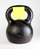 Черное kettlebell с пустая тяжелой Стоковые Фото