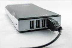 Черное Powerbank с заткнутым кабелем Стоковое фото RF