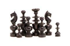 черной ретро chessmans изолированное группой Стоковая Фотография RF