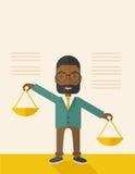 Чернокожий человек держа веся масштаб Стоковое Изображение RF