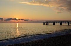 чернота над заходом солнца моря Стоковая Фотография