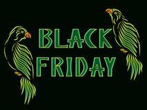 Чернота пятница надписи с желт-зелеными попугаями стоковые фото