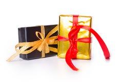 Чернота смычка 2 подарочных коробок красная желтая Стоковая Фотография