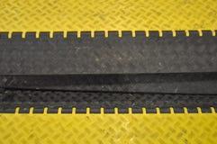 чернота bumps желтый цвет скорости горбов Стоковые Фотографии RF