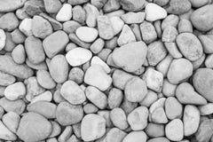 Черно-белая текстура предпосылки каменной стены Стоковая Фотография