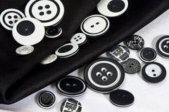 Черно-белые кнопки Стоковые Изображения