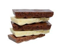 Черно-белый пористый шоколад на белой предпосылке Стоковая Фотография RF
