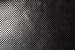 Черно-белым пефорированная градиентом кожаная предпосылка текстуры Стоковые Фото