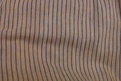 Черно-коричневая текстура от части striped материала Стоковое Фото