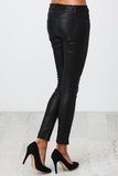 Черные брюки на белизне стоковая фотография