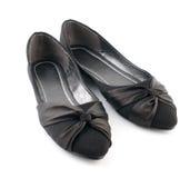 Черные вскользь ботинки женщины стоковая фотография