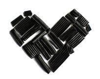 Черные в форме сердц конфеты лакрицы солодки стоковое фото rf