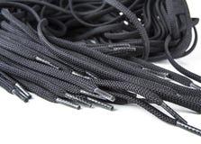 Черные запасные шнурки ботинка на белой предпосылке Стоковое фото RF
