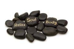 черные камни спы массажа стоковое фото