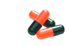 черные капсулы над белизной красного цвета 3 Стоковая Фотография RF