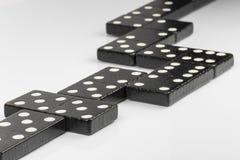 Черные кирпичи домино Стоковое Фото