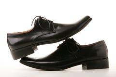 черные классицистические ботинки стоковые изображения rf