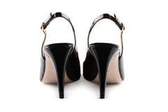 черные кожаные ботинки патента изолированная белизна вид сзади Стоковое Фото