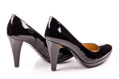 черные кожаные ботинки патента Стоковое фото RF