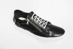 черные кожаные ботинки людей s Стоковые Изображения RF