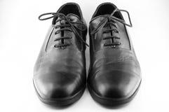 Черные кожаные ботинки стоковое фото