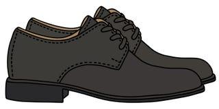черные кожаные ботинки Стоковые Изображения