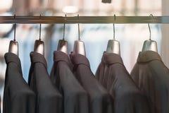 Черные костюмы стоковое изображение