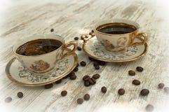 Черные кофейные чашки 3 Стоковые Фото