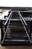 Черные лестницы пожарной лестницы металла Стоковые Фото