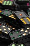 Черные домино цвета с красочной точкой Стоковые Изображения RF