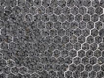 Черные песчинка, гравий или лачуга уловленные в белом пластиковом соте стоковое фото rf