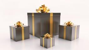 Черные подарочные коробки с золотым смычком ленты на светлой предпосылке стоковое изображение rf